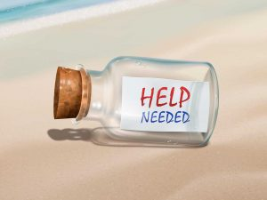 help needed message in a bottle isolated on beautiful beach