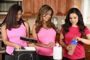 Women working together on making best pre workout for women shakes for the week