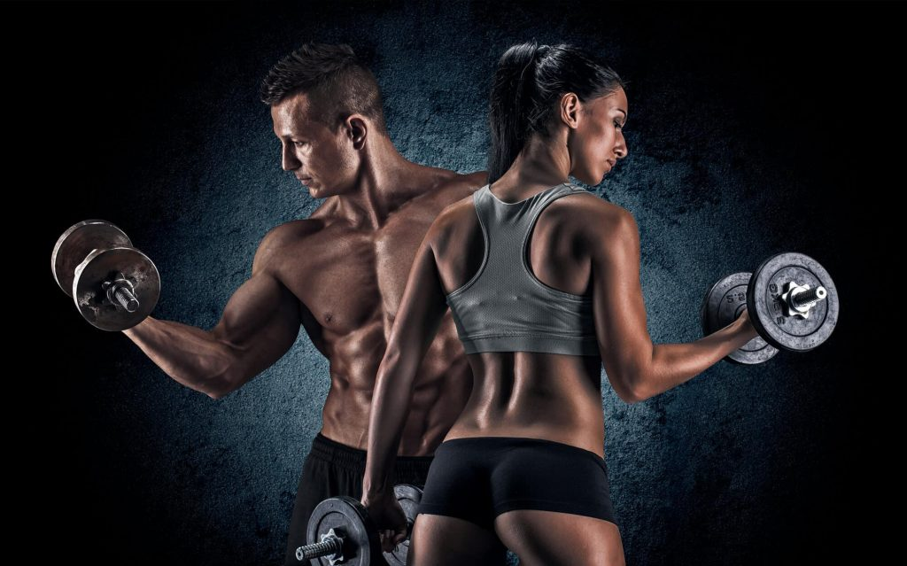 Man and woman isolated on a dark background showing off muscles after using Ostarine Mk 2866