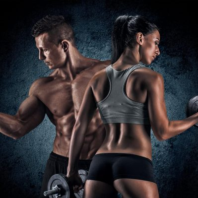 Man and woman isolated on a dark background showing off muscles after using Ostarine