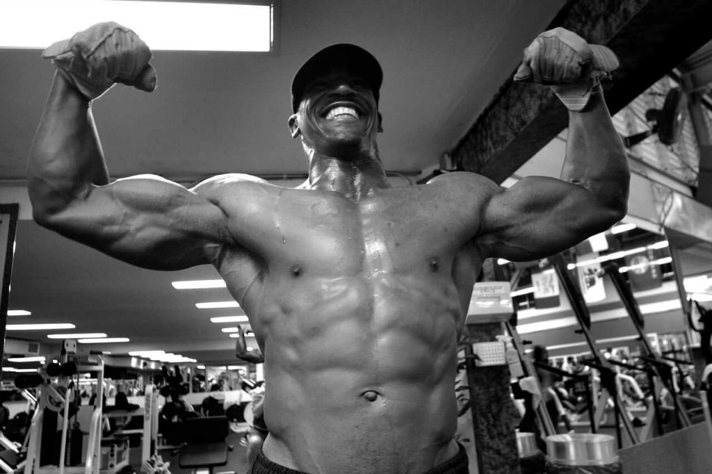 man flexing muscles on winstrol stanozolol